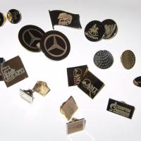 Значки изготовлены из металлических заготовок, нанесение выполнено методом лазерной гравировки.